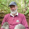 Chris holds a male and female kiwi-pukupuku (little-spotted kiwi) (photo by Helen Taylor)